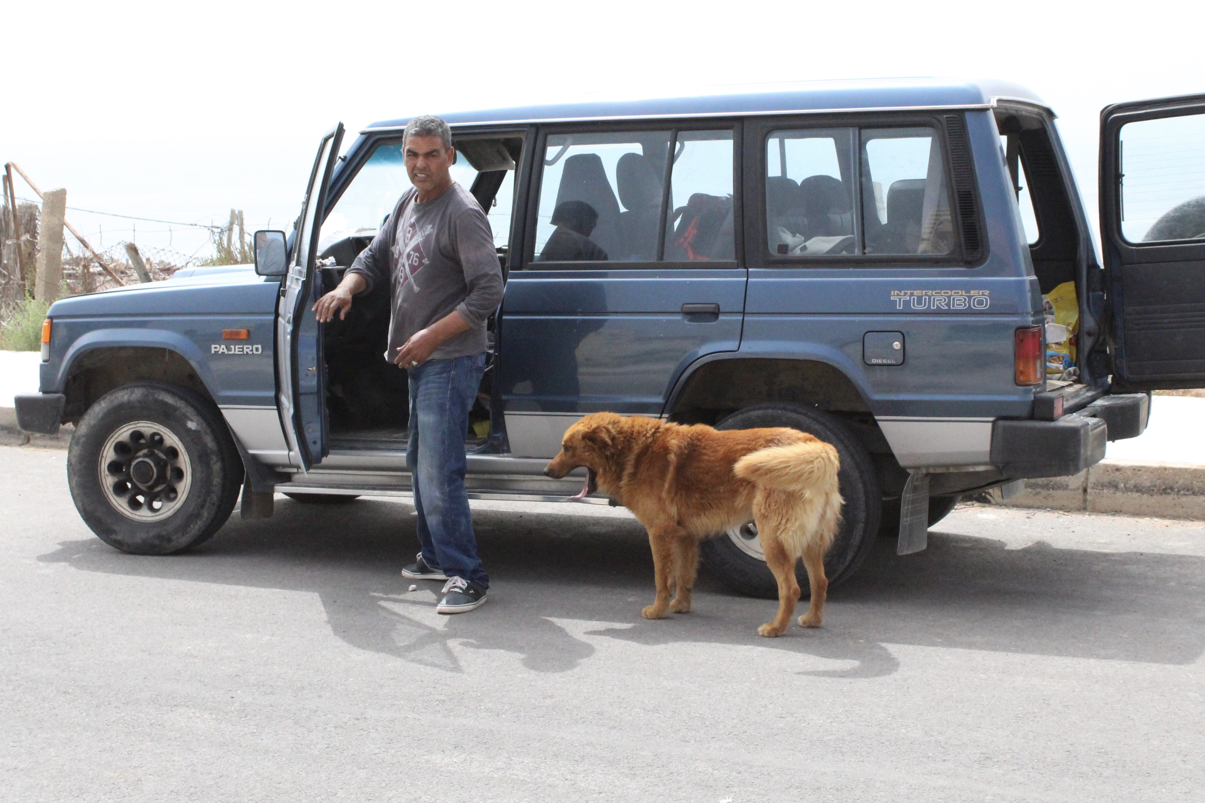 Yusef in front of his car in Morocco