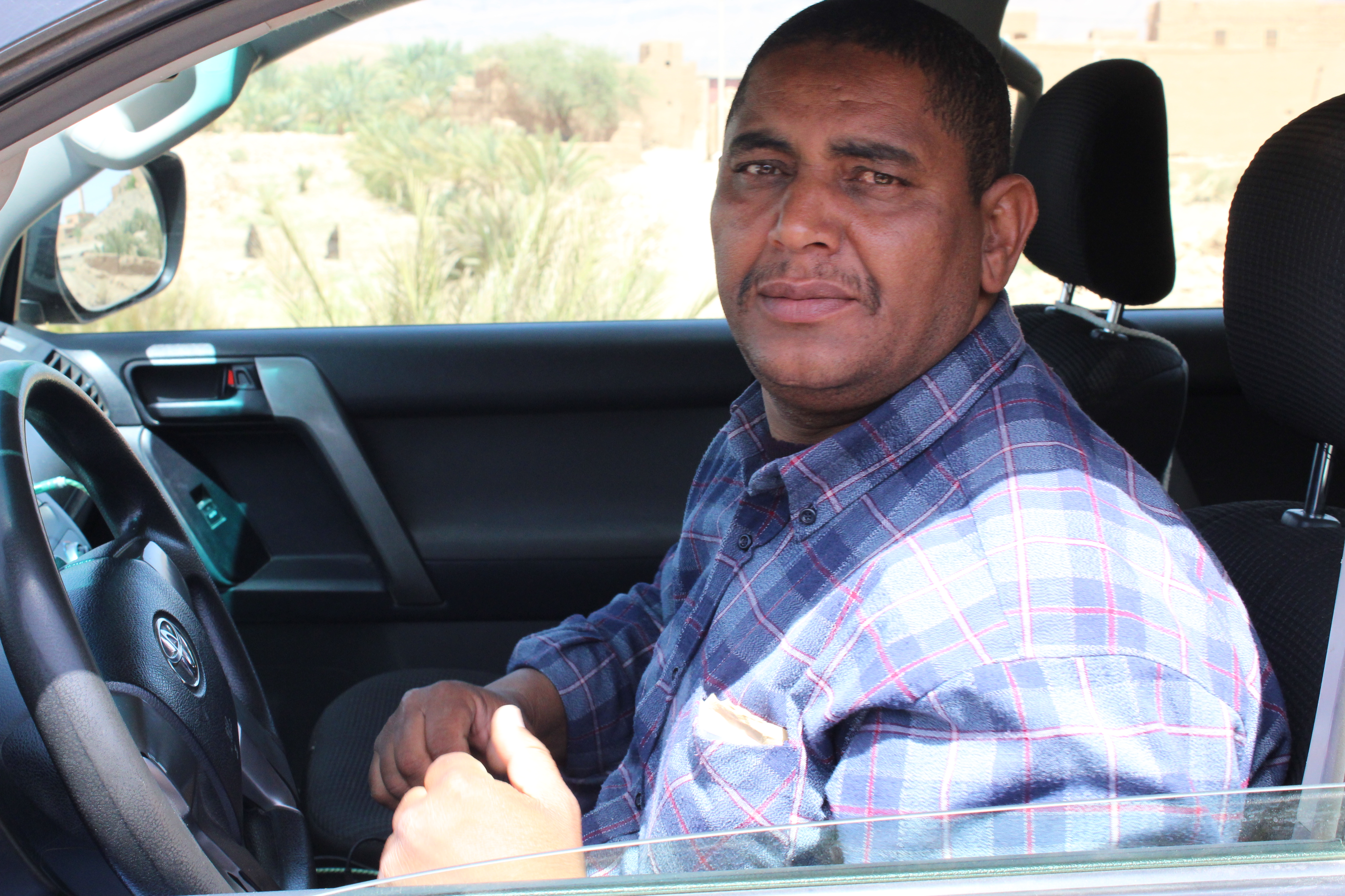Abdul in his car in Morocco